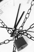 Clock bound with chain and padlock Stock Photos