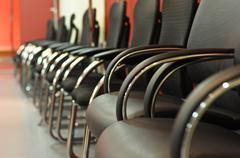Black leather office chair close-up Stock Photos