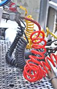 colorful Pneumatic hoses between the truck and trailer - stock photo