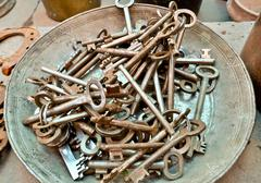 a lot of old brass key on an old plate - stock photo