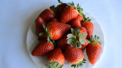 Stock Video Footage of Strawberries Spin on a Plate