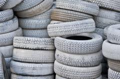 The white automobile tires dumped in a a big pile Stock Photos