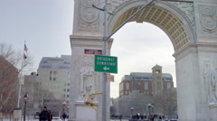 Washington Square Park arch Broadway downtown sign winter snow 4K NYC - stock footage