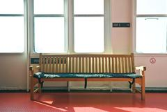 Wooden bench in the interior lit by bright sunshine Stock Photos