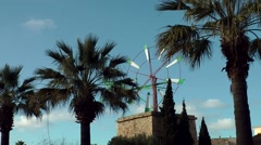 Spain Mallorca Island small town Sa Coma 001 Spanish windmill between palm trees Stock Footage