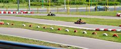 go kart racing on circuit - stock photo