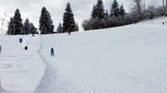 Adorable little boy, skiing for the first time on a big hill Stock Footage