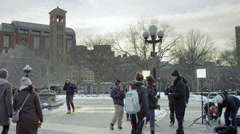 Film crew Washington Square Park NYU students filming cold winter snow 4K NYC Stock Footage