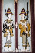Thai style molding art on the door at Wat Phra Kaew temple, Thailand. - stock photo