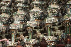Demon Guardian statues decorating the Buddhist temple Wat Arun in Bangkok, Th - stock photo