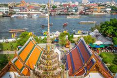 View at the temples of Wat Arun and Chao Phraya River, Bangkok - stock photo