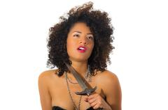 beautiful exotic young tribal woman holding a dagger - stock photo