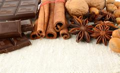 Romantic set of chocolate,anise,nuts and cinnamon on white flax Stock Photos