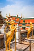 Golden Angle at Wat Phra Kaeo, Temple of the Emerald Buddha and the home of t - stock photo