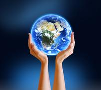 Hands holding planet earth - stock photo