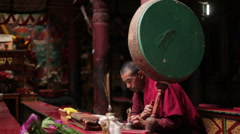 Unidentified Tibetan Buddhist monk praying in Hemis gompa, Ladakh Stock Footage