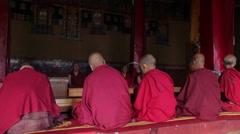 Tibetan Buddhist monks praying in Diskit gompa, India Stock Footage