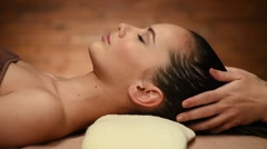 Masseur strokes the hairs on head. Woman in spa salon. Spa treatments Stock Footage