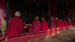 Tibetan Buddhist monks praying in Diskit gompa, India Stock Footage