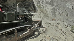 Bulldozer doing mountain road construction in Himalayas. Himachal Pradesh, India Stock Footage