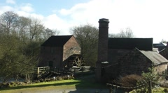 Watermill and water wheel old blue sky Stock Footage