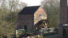 Watermill water wheel shadows old heritage vintage Stock Footage