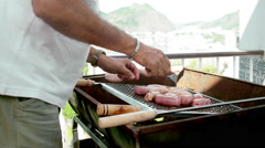 Man preparing authentic Brazilian BBQ Stock Footage