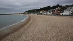 Waves lapping Lyme Regis beach Dorset England UK Stock Footage