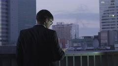 Businessman on the Phone while Being on Roof Stock Footage