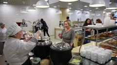 Lunch in the canteen. Visitors to the cafeteria for meals. Stock Footage
