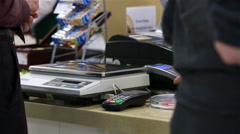 The customer pays at the checkout by credit card. Stock Footage