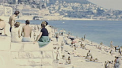 Nice 1965: people relaxing on the beach Stock Footage