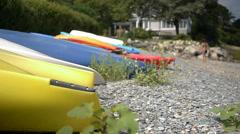 Dinghies on pebble beach Stock Footage