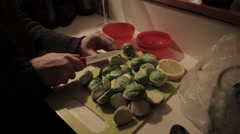Preparing Brussels sprouts for dinner Stock Footage