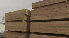 Stacks of pre-nailed framing on a construction site - stock footage