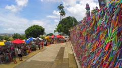 Colorful religious Brazilian wish ribbons Fita do Bonfim in Salvador, Brazil Stock Footage