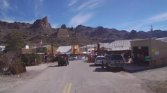 View Of Motorcycle Rider Through Oatman Arizona Stock Footage