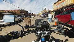 View Of Motorcycle Rider Thru Oatman Arizona- Wide Angle Stock Footage