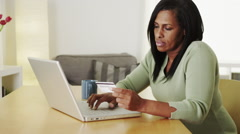 Senior black woman shopping online laptop computer Arkistovideo