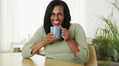 Senior black woman drinking hot coffee Stock Footage