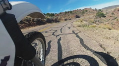 Low Angle Motorcycle Tire On Curving Route 66- Fast Motion Stock Footage