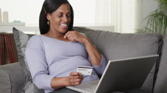 Excited senior black woman buying online on laptop computer Stock Footage
