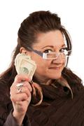 Stock Photo of Woman Holding Cash