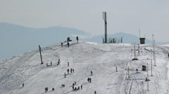 4K Skiers at the ski slope mountain top, snowy peaks of the Alps. UHD stock v Stock Footage