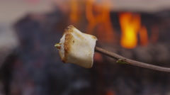 Roasted marshmallow by campfire. Shot on RED EPIC for high quality 4K, UHD, Stock Footage