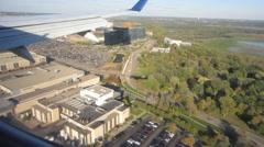 Landing at MSP with cool aircraft shadow realtime Stock Footage