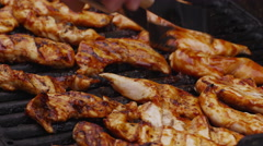 Chicken cooking on grill. Shot on RED EPIC for high quality 4K, UHD, Ultra HD Stock Footage