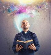Stock Photo of Priest observes universe light