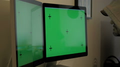Anonymous man looks at screens with green screen and track markers Stock Footage