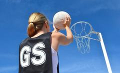 Woman Shoots a Netball - stock photo